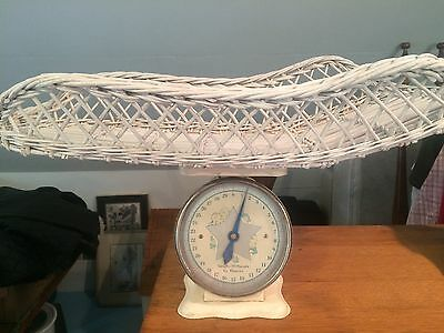 Antique baby scale with rattan wicker basket