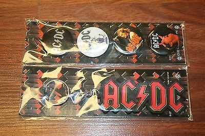 New in Package - AC/DC Key Chain & Button Set. Set of 4 Buttons