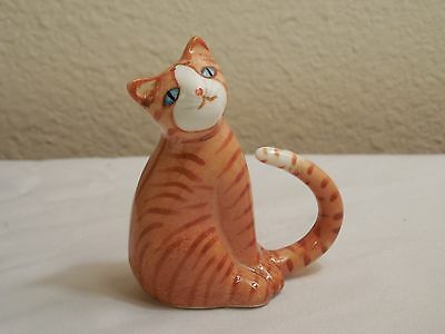 Fine Bone China Orange Striped Cat Figurine With Blue Eyes And A Curled Tail