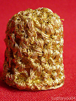 Gold Coloured Material Covering A Wooden Collectors Thimble