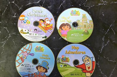 Lot of 9 Dora the Exlporer DVD's guaranteed to play disc only S-21 #494