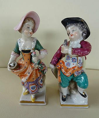 Pair of Continental Chelsea Derby Porcelain Figures in Period Dress