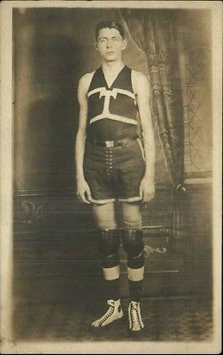 Young Man Basketball Player Old-Timey Uniform Knee Guards Real Photo Postcard