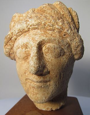 Ex Sotheby's Cypriot Limestone Head of a Priest or Votary, 5th Century B.C.