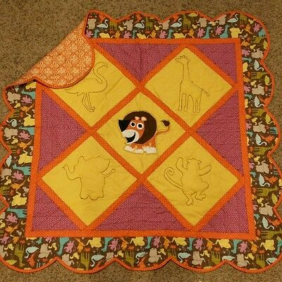 Handmade baby quilt with baby animals