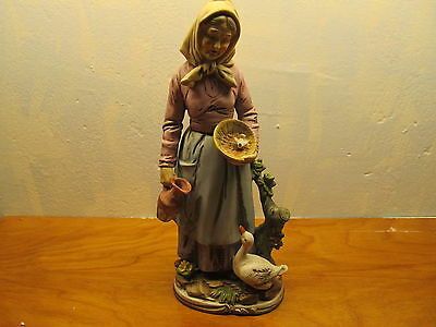 homco figurine of old woman with goose