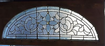 Jeweled antique stained glass arch window