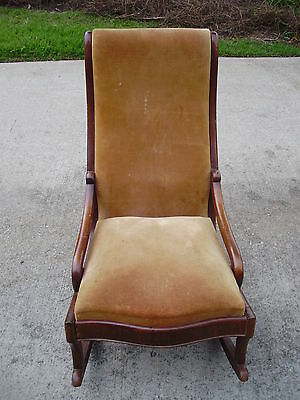 Antique Victorian walnut upholstered rocking chair with horsehair cushion