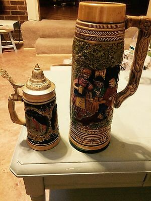 vintage german beer stein and tall beer mug