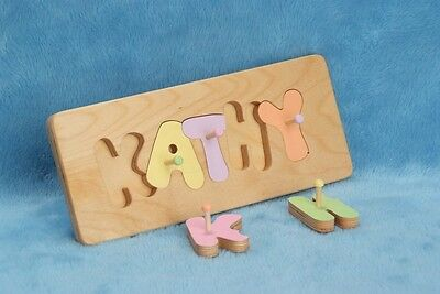 Childrens Handcrafted Wooden Name Puzzle with pegs