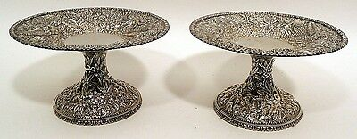 A large pair of floral repousse sterling tazzas. S. Kirk & Son.