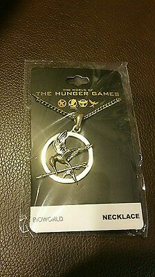 The Hunger Games Mockinjay Necklace Gold color Lootcrate level up exclusive.