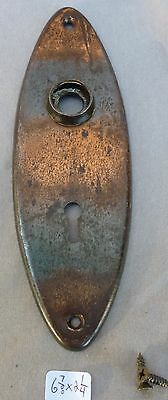 "Door Knob Back Plate OVAL flashed copper plated over steel  6 7/8""h x 2 1/4""w"