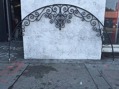 Spanish Revival Arched Banded Iron Window Grid