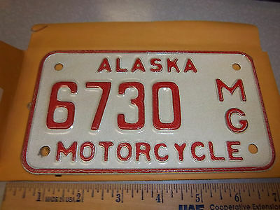 Alaska Motorcycle License Plate numbered 6730, NEW and Unused, expired in 1976