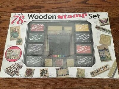 78 pc WOODEN STAMP SET IN AN ALUMINUM CASE