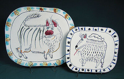 Pair of Hand Crafted and Signed Pottery Dog Wall Plates