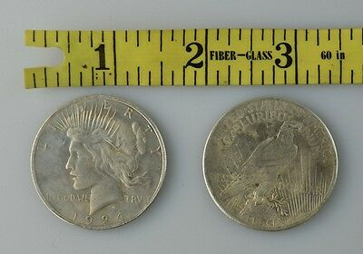 Silver Dollar Metal Coin Copy Paperweight attracted to magnetic close up Replica