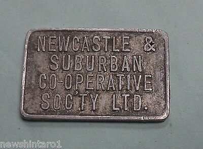 #d275. Newcastle & Suburban  Bakery Aluminium  Bread Pint  Milk Token