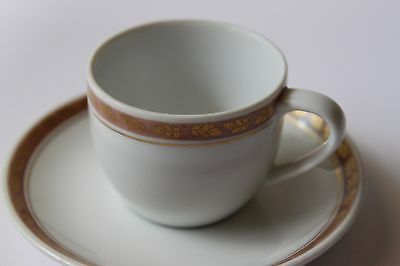 KPM Cup and Saucer First Quality White With Gold Trim.
