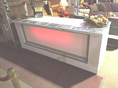 Buffet Table With Red Front Under Lighting