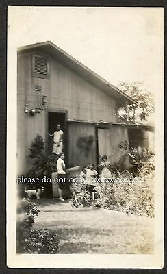 C. 1928 Smiling young Ladies and native Children gathered outside home, Hawaii