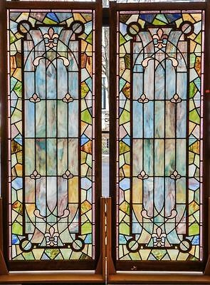 Monumental pair of matched stained glass windows
