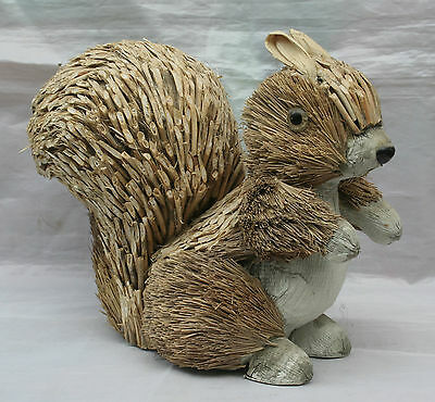 Charming Squirrel made of Pine Needles, straw quills and raffia, glass eyes.