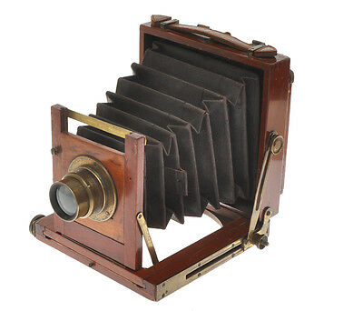 Small wooden folding camera 8x10cm (English?) with unmarked brass lens F:8