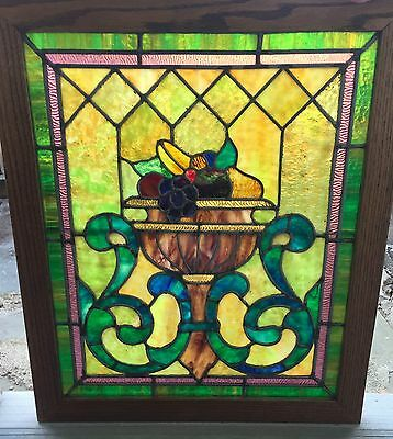 One of a matched pair of fruit bowl stained glass windows