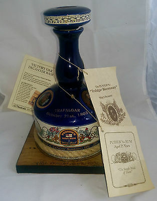 A Pusser's Trafalgar Bicentenary Rum Decanter and Wooden Stand from HMS Victory
