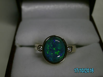 LIGHTNING RIDGE SOLID BLACK OPAL, HAND CRAFTED 9 Ct GOLD AND DIAMOND RING