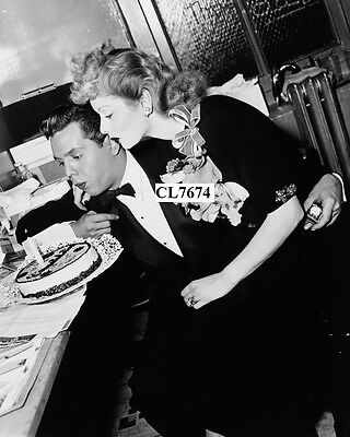 Lucille Ball and Desi Arnaz Blow Out the Candles on a Birthday Cake Photo
