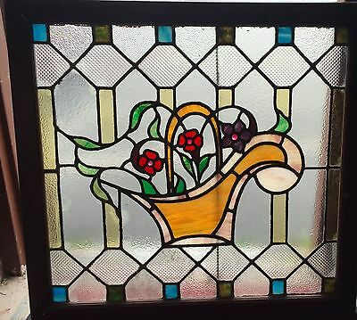 1 of a matched pair of floral stained glass windows