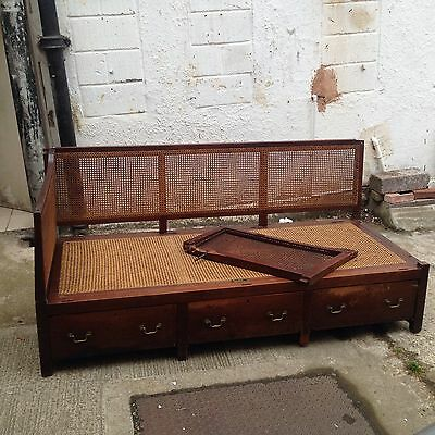 An Eary 19Th Century Mahogany Campaign Settee