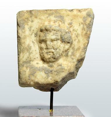 Roman marble figure of a bearded male: Circa 3rd-4th century AD.