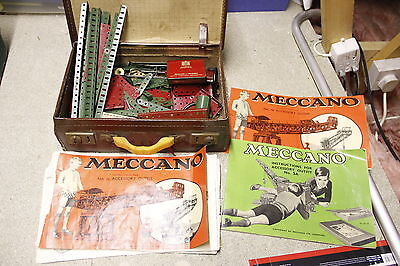 vintage lot of Meccano with catalogues in vintage brown suit case