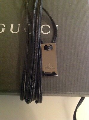 Gucci Tag on leather string, cool piece. Wear as a belt, necklace or a bracelet