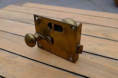 Vintage brass door handle with keyless locking mechanism