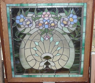 Bouquet of flowers in this antique stained glass window