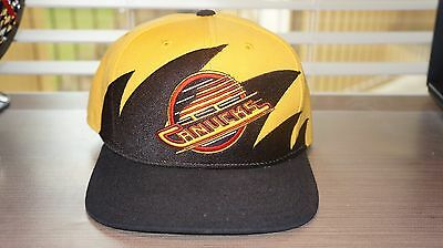 Vancouver Canucks Sharktooth Snapback Hat Black Yellow Mitchell   Ness 5f08d766a773