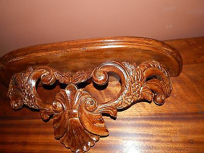 Completely hand carved wood Shelf.  Beautiful and precise details. Light Walnut.