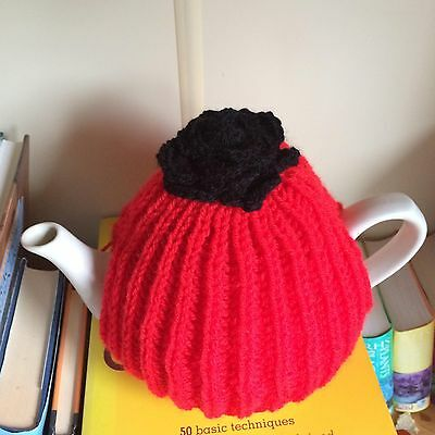 Red Hand Knitted Aran Style Tea Cosy with Black Flower