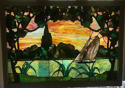 Spectacular stained glass window featuring sailboat on a lake