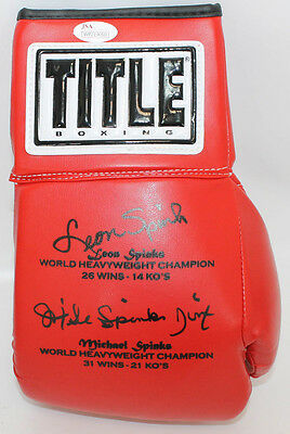Michael and Leon Spinks Autographed Boxing Glove JSA COA