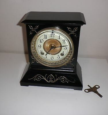 Ansonia cast iron clock, early 20th C (over 100 years old) working
