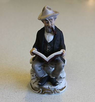 Vintage Bisque Old Man Smoking Pipe and Reading Figurine