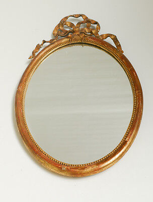 Genuine Antique Plaster Oval Wall Mirror in Ribbon Decorated Gilt Frame.