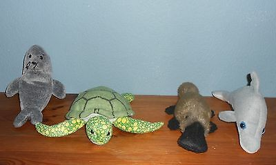 4 Water animal soft toys in good condition. Each about 20cm long.
