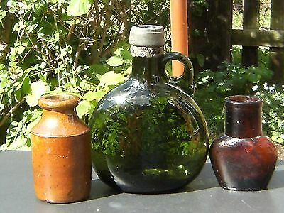 Collection of antique glass and stoneware bottles